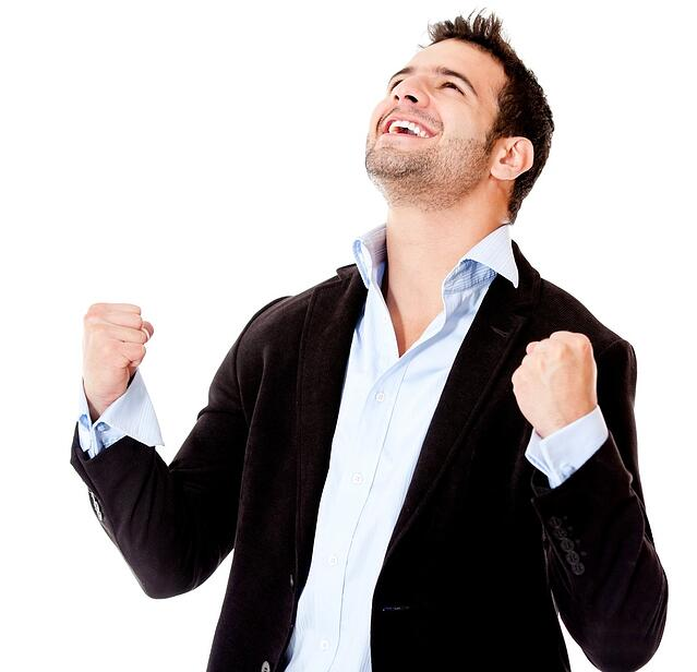 Successful businessman celebrating - isolated over a white background.jpeg